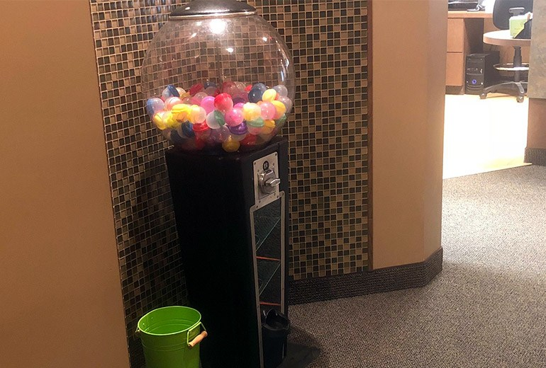 Gum ball machine with small toys