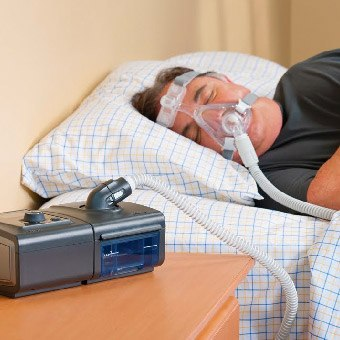 Man with BiPAP mask in place