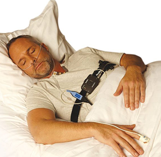 Man sleeping with test device in place