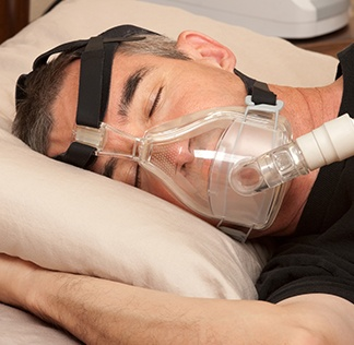 Man sleeping with CPAP system