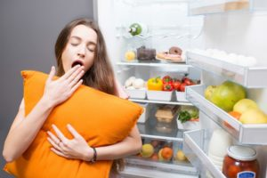 tired woman open refrigerator