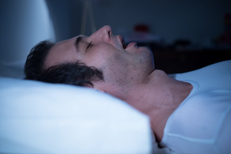 a man sleeping with his mouth open