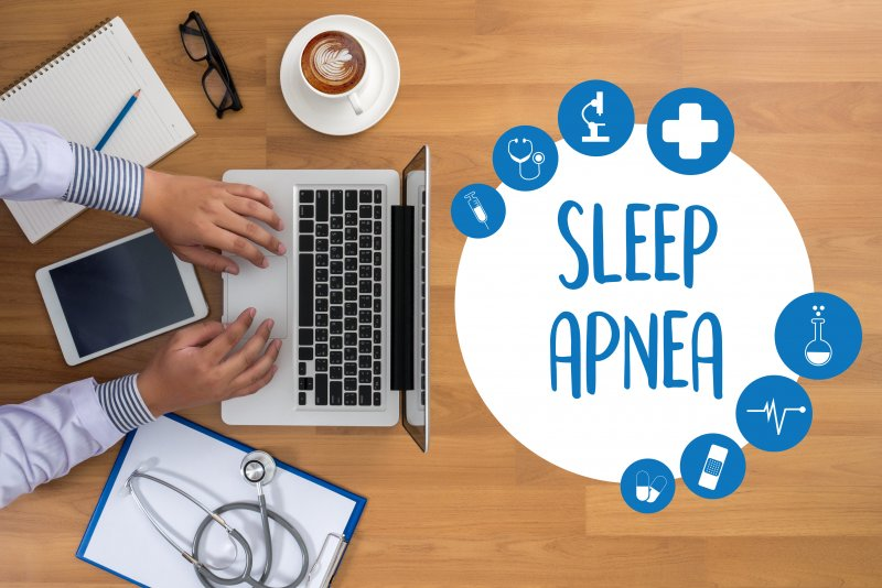 "a person on the computer with an image reading ""Sleep Apnea"" nearby"