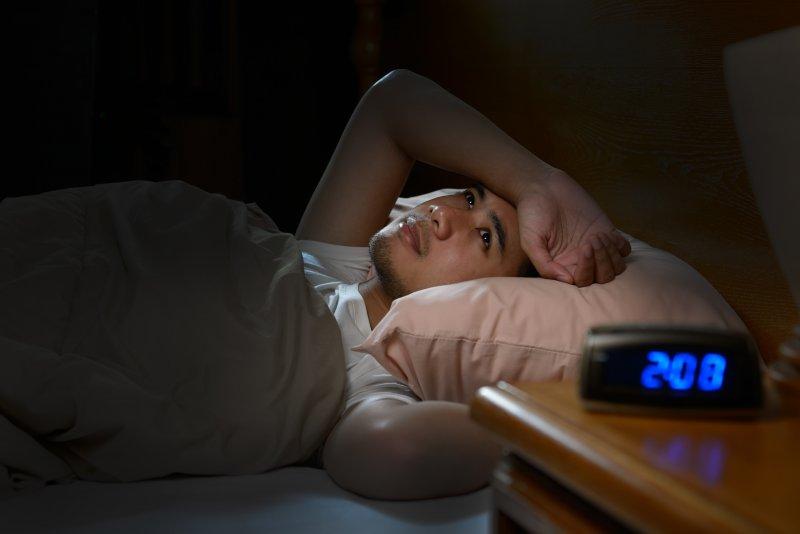 a young individual awake at 2:08 a.m. because of stress